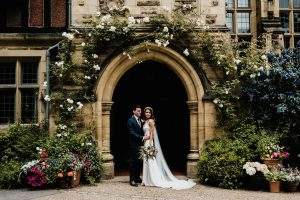 Sarah and her new husband Chris, wearing Petunia wedding dress by Suzanne Neville, at her Jesmond Dene House wedding in Newcastle England